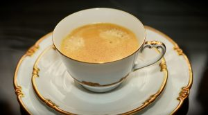A porcelain cup of coffee.