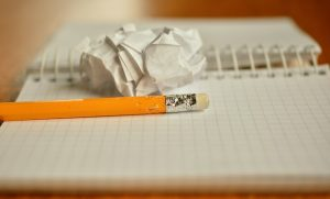 Chewed pencil, paper ball