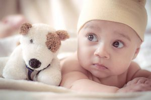 baby and a plush toy