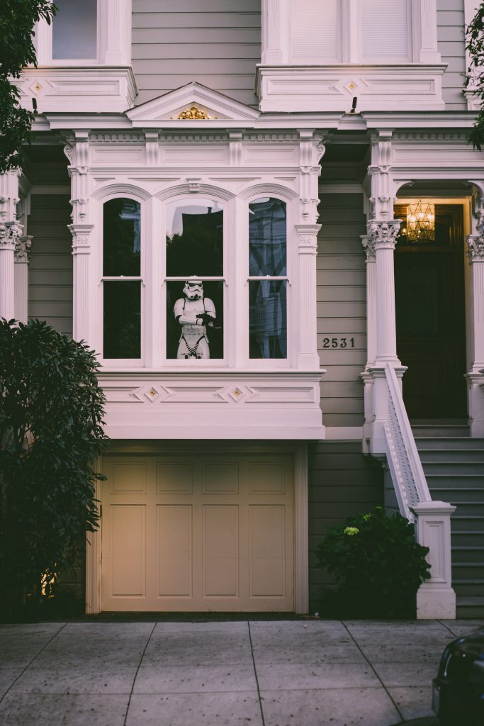 A Victorian house with a stormtrooper cutout in it.