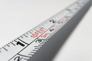 Measuring tape used to know the precise size of the affordable storage unit in Queens