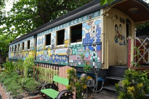 Train wagon turned into a home with garden