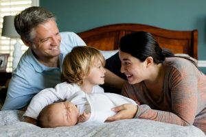 A happy family that is safe in one of the best Long Island City neighborhoods for families with children